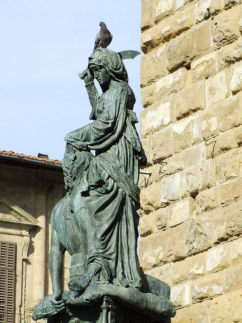 Photo of Judith and Holofernes by Donatello. The bronze statue is in front of the Palazzo.