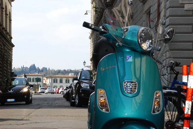 Riding a Vespa in Florence